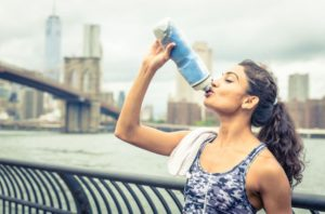 Image of Athlete Drinking Superieur Electrolyte Drink Mix